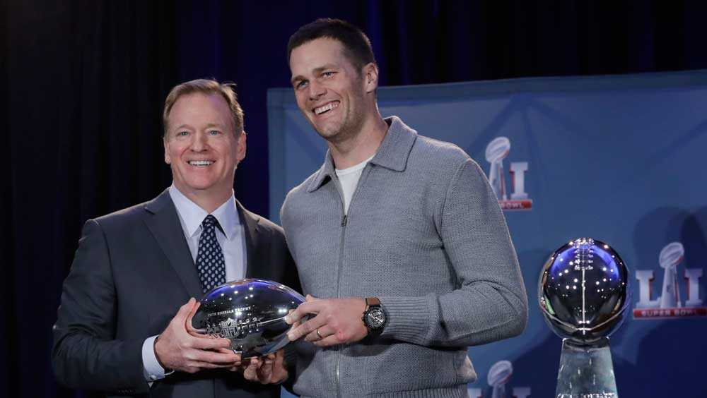 NFL commissioner Roger Goodell and New England Patriots quarterback Tom Brady pose with the MVP trophy during a news conference after the NFL Super Bowl 51 football game Monday, Feb. 6, 2017, in Houston. Brady was named the MVP of Super Bowl 51.