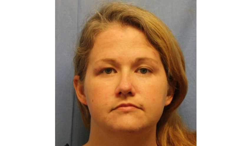 Woman is charged with harboring killer of Clinton Officer Gary Michael