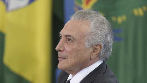 Brazil's President Michel Temer looks on during a ceremony at the Planalto Presidential Palace, in Brasilia, Brazil, Tuesday, March 7, 2017. Brazil's economy has fallen sharply for a second consecutive year, putting Latin America's largest country in its deepest recession in modern history.