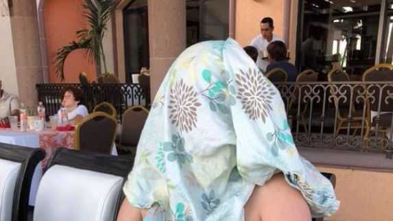 "Woman covers face with blanket after reportedly told to ""cover up"" during breastfeeding."