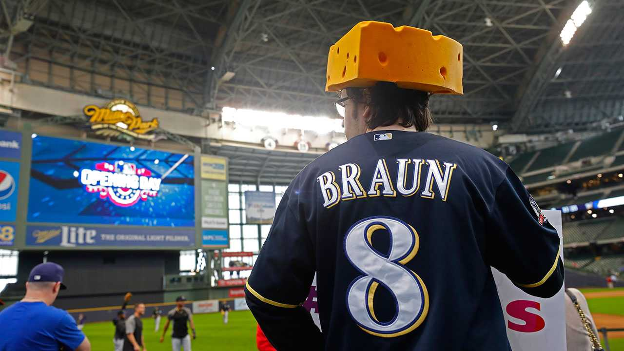 A fan watches pre-game activity inside Miller Park before an opening day baseball game between the Colorado Rockies and Milwaukee Brewers Monday, April 3, 2017, in Milwaukee.