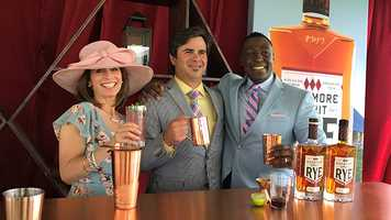 Brian Treacy, president of Sagamore Spirit, with Deborah Weiner and Andre Hepkins at Pimlico