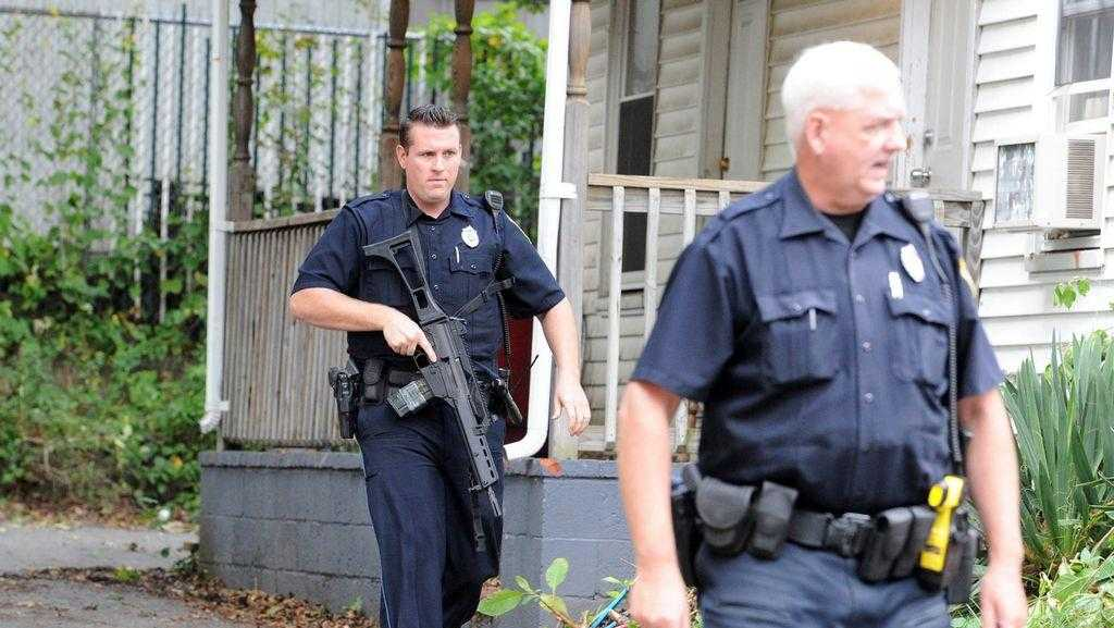 When Brockton police respond to serious 911 calls, such as this stabbing on Hamilton Street in October 2016, many are armed with long rifles.