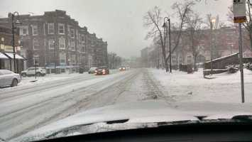 Snowy road conditions in Brookline