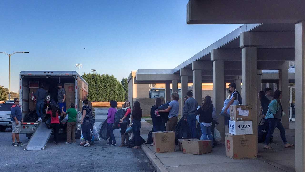 Students at Broome High fill a truck with donations for students on the other side of the state who lost everything to Hurricane Matthew
