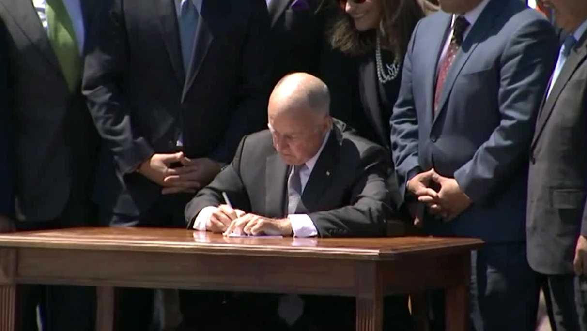 Gov. Jerry Brown signed a bill into law Tuesday, July 25, 2017, that extends  of one of the most ambitious programs in the U.S. to reduce fossil fuel pollution. The legislation was signed during a ceremony overlooking San Francisco.