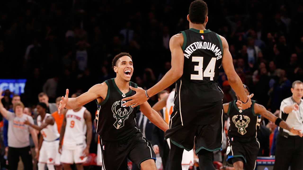 Milwaukee Bucks' guard Malcolm Brogdon (13) reacts as he runs toward Milwaukee Bucks' forward Giannis Antetokounmpo (34) who hit a buzzer-beater to defeat the New York Knicks in the waning seconds of an NBA basketball game at Madison Square Garden in New York, Wednesday, Jan. 4, 2017. The Bucks defeated the Knicks 105-104 on Antetokounmpo's shot.