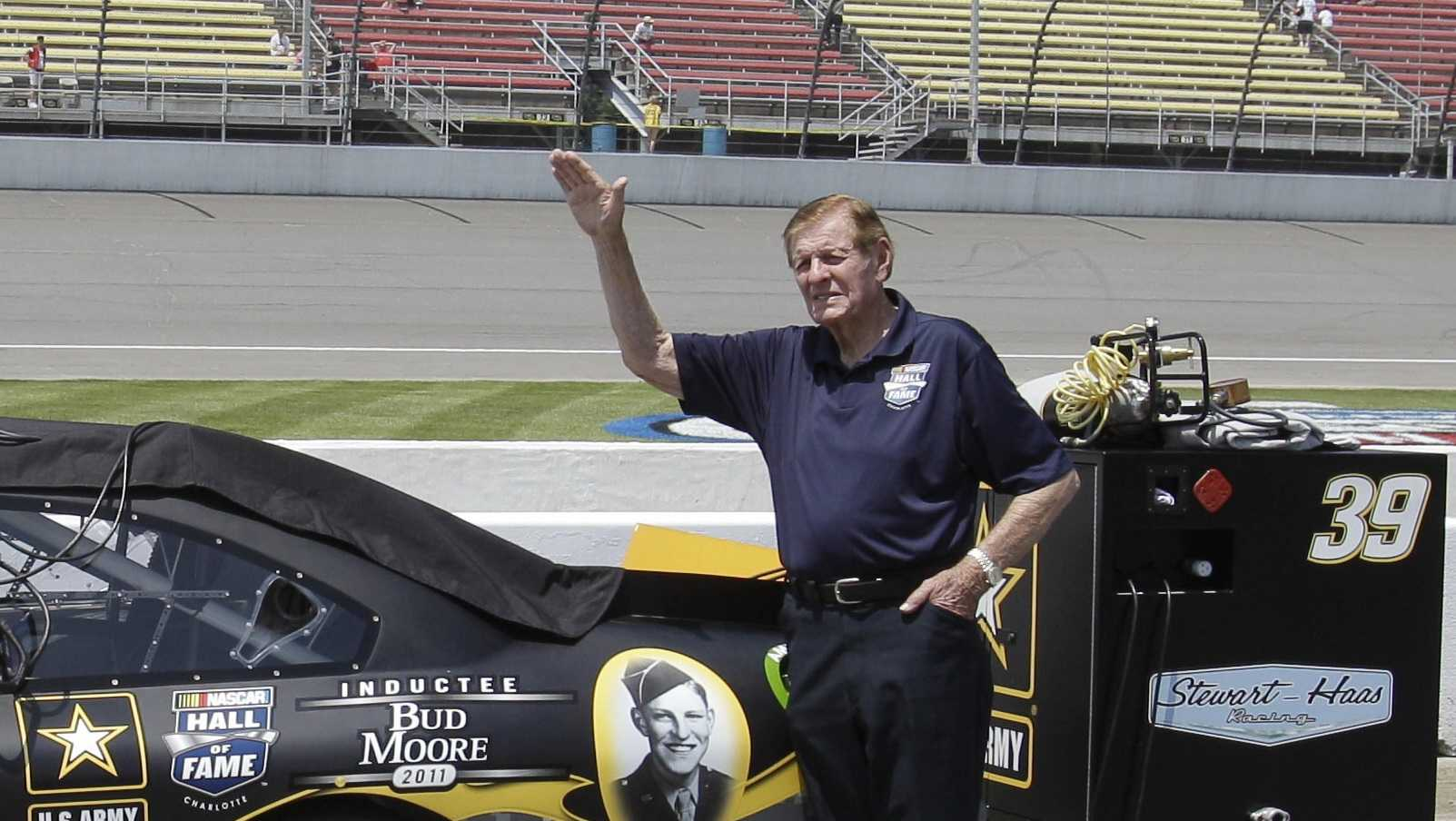 In this June 18, 2011, file photo, NASCAR Hall of Famer Bud Moore stands next to Ryan Newman's car before qualifying laps for a NASCAR Sprint Cup Series auto race at Michigan International Speedway in Brooklyn, Mich. NASCAR Hall of Famer Bud Moore, a World War II veteran awarded five Purple Hearts and two Bronze Stars, has died. He was 92.