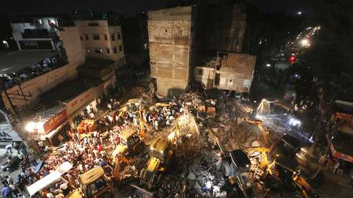 Rescuers work on the debris after a rickety hotel building collapsed in Indore, Madhya Pradesh state, India.