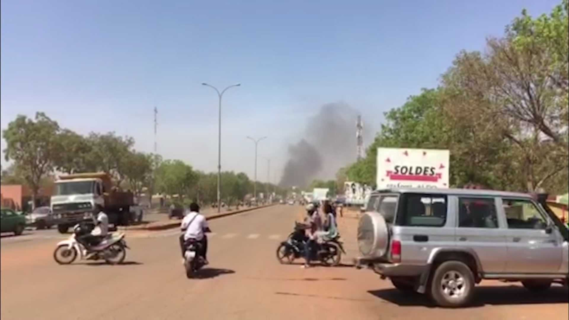 Smoke rises in the background in Ouagadougou, Burkina Faso in this image taken from video Friday March 2, 2018.