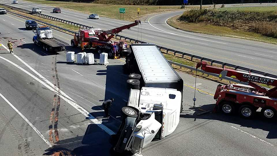 A tractor-trailer overturns and blocks Business 85 in Greensboro.