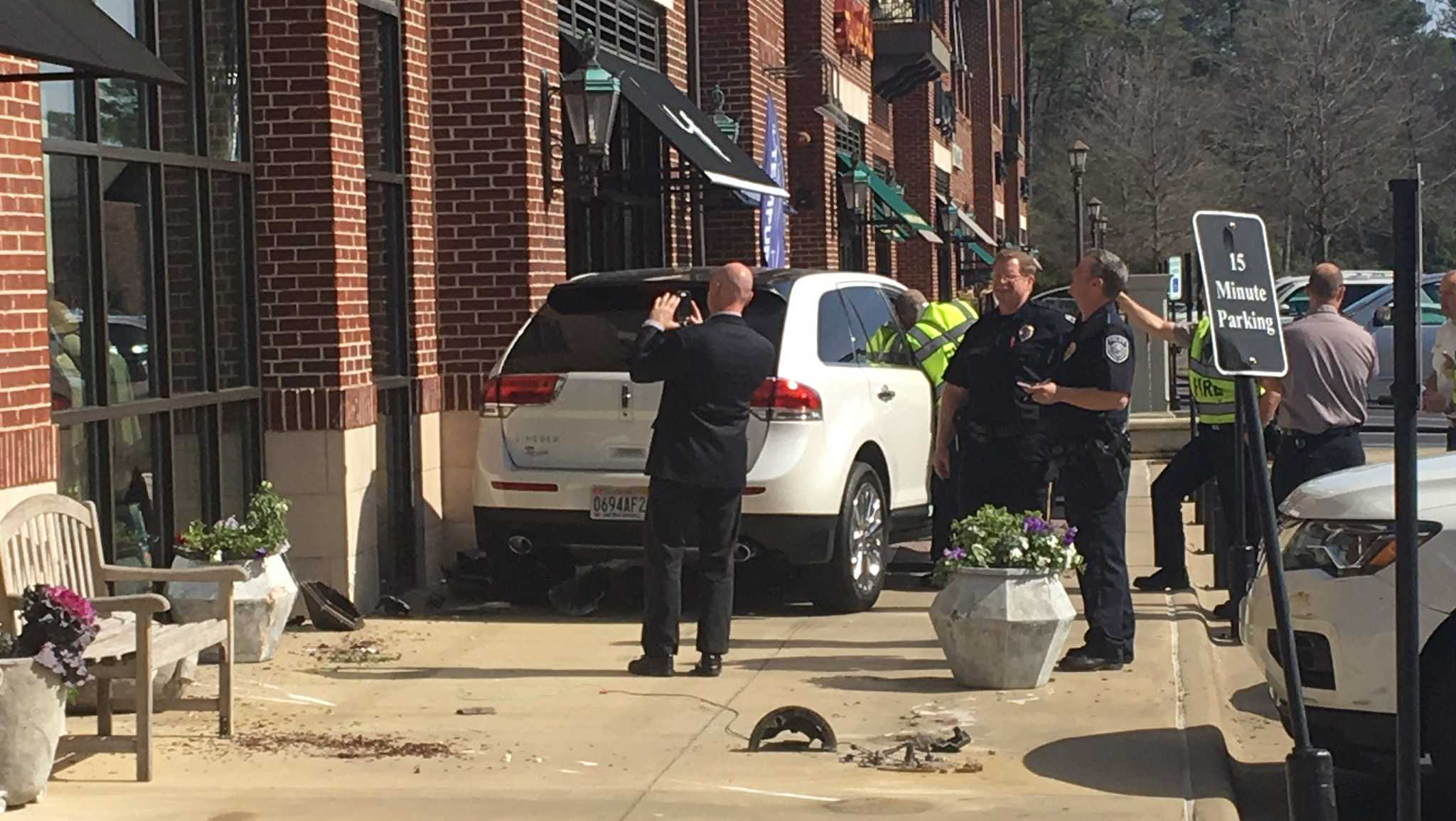 An SUV jumped the curb and crashed into a light pole at the Cahaba Village Plaza shopping center in Mountain Brook on Friday.