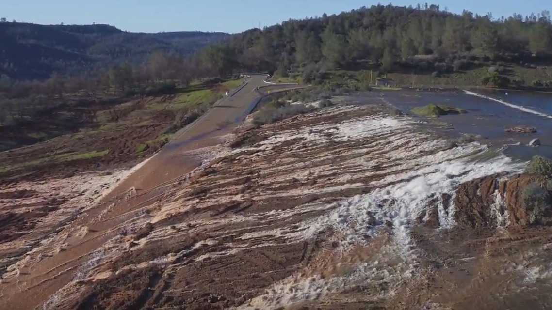 Water flows over the emergency spillway at Lake Oroville decreased Sunday, Feb. 12, 2017. By the afternoon, the flow was down to 8,000 cfs from peak of 12,600 cfs at 1 a.m.