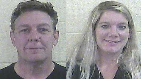 IN couple accused of locking daughter in cage without food, water