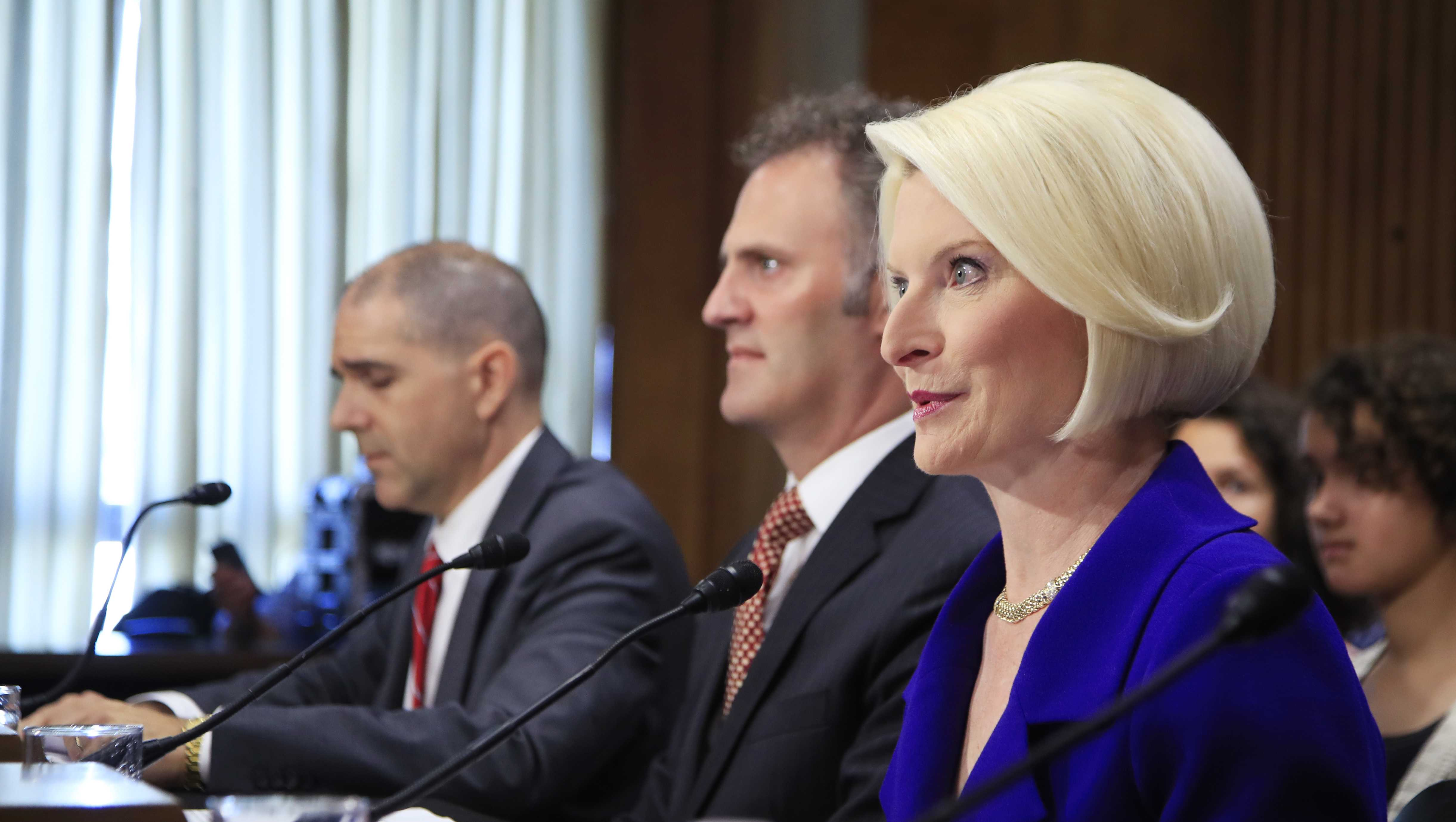 Callista Gingrich of Virginia, right, speaks on Capitol Hill in Washington, Tuesday, July 18, 2017, during a Senate Foreign Relations Committee hearing on her nomination to become U.S. Ambassador to the Vatican. Nathan Alexander Sales of Ohio, nominated to be Coordinator for Counterterrorism, with the rank and status of Ambassador at Large is at center, and Carl Risch of Pennsylvania, nominated to be an Assistant Secretary of State's Consular Affairs is at right.