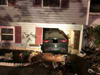 Car crashes into home