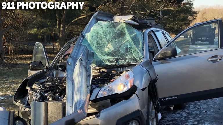 Car hits guardrail