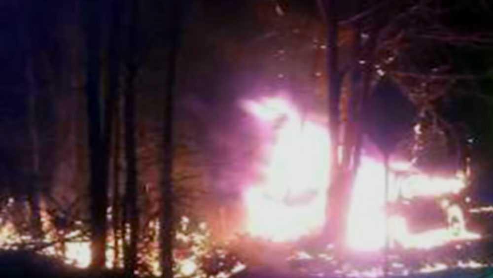 Karl Addis Jr,'s car burning after crash