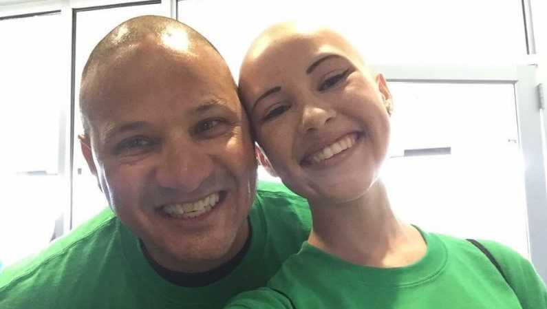 Carlie Gonzalez and her father, Steven Gonzales, show off their bald heads at the One Mission Buzz Off last summer.