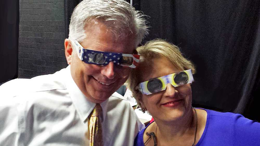 Michael Cogdill nd Carol Goldsmith in eclipse glasses