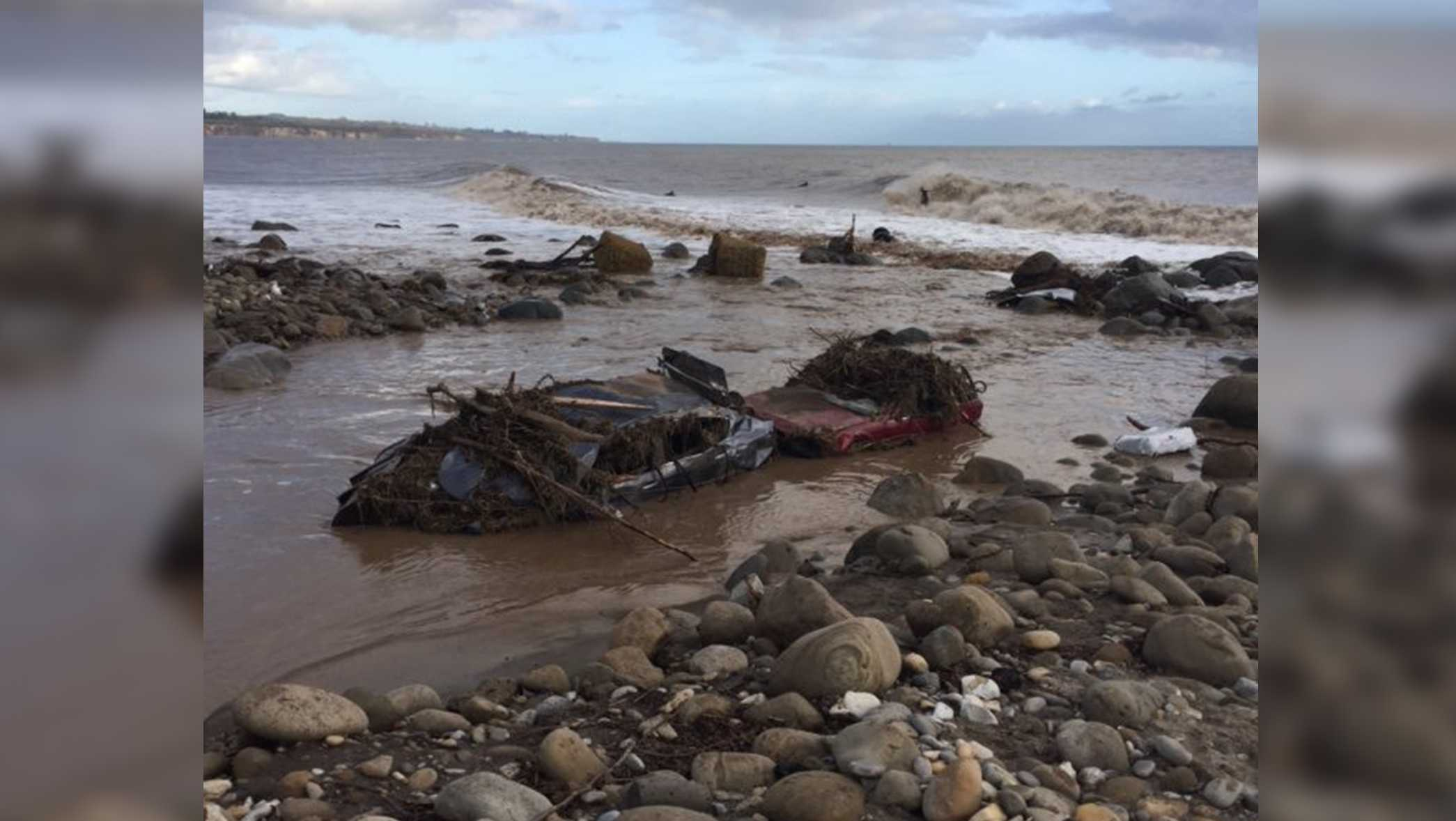 Five cars washed up onto a beach after flooding at the El Capitan State Beach in Santa Barbara County, the California Department of Fish and Wildlife said in a tweet. Jan. 20, 2017