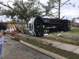 Big trees toppled and large truck overturned in New Orleans East.