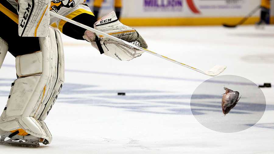Penguins goalie Marc-Andre Fleury flips a catfish off the ice in Nashville.