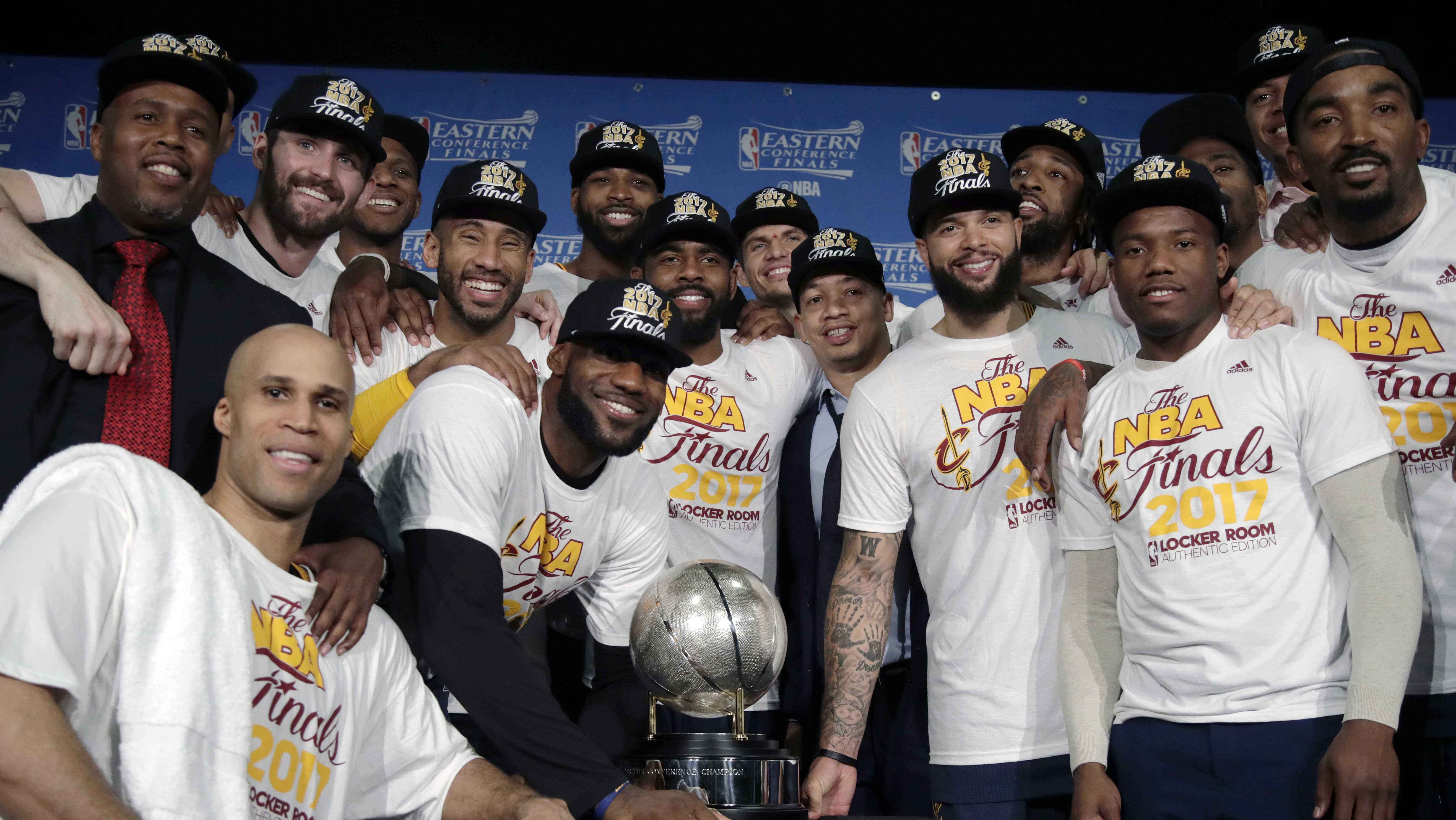 The Cleveland Cavaliers pose with their trophy after winning Game 5 of the NBA basketball Eastern Conference finals against the Boston Celtics 135-102, on Thursday, May 25, 2017, in Boston.
