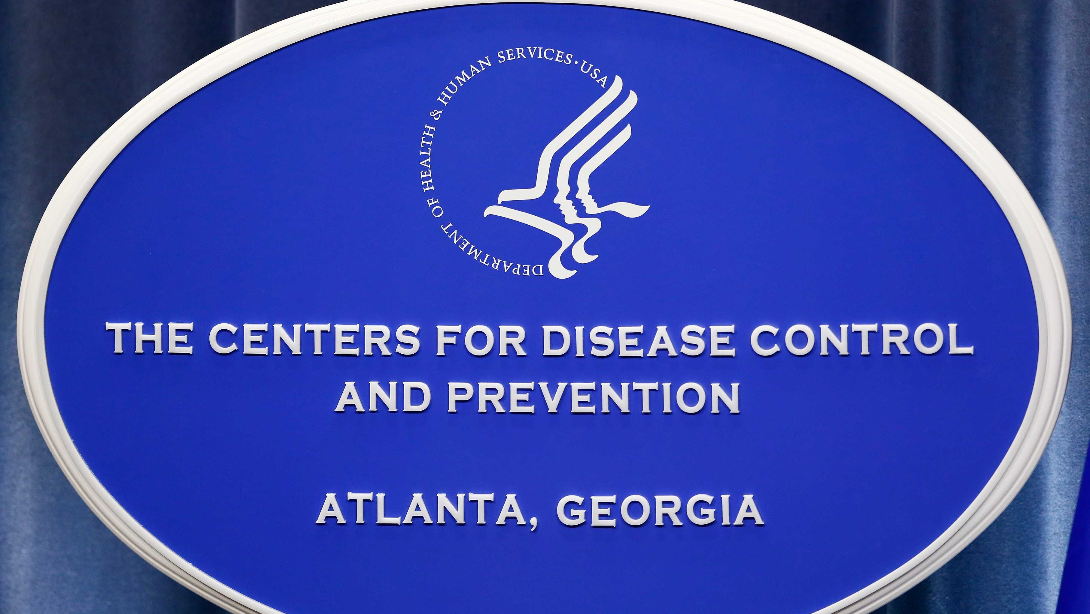 A sign with the logo for the Centers for Disease Control and Prevention at the Tom Harkin Global Communications Center on October 5, 2014 in Atlanta, Georgia.