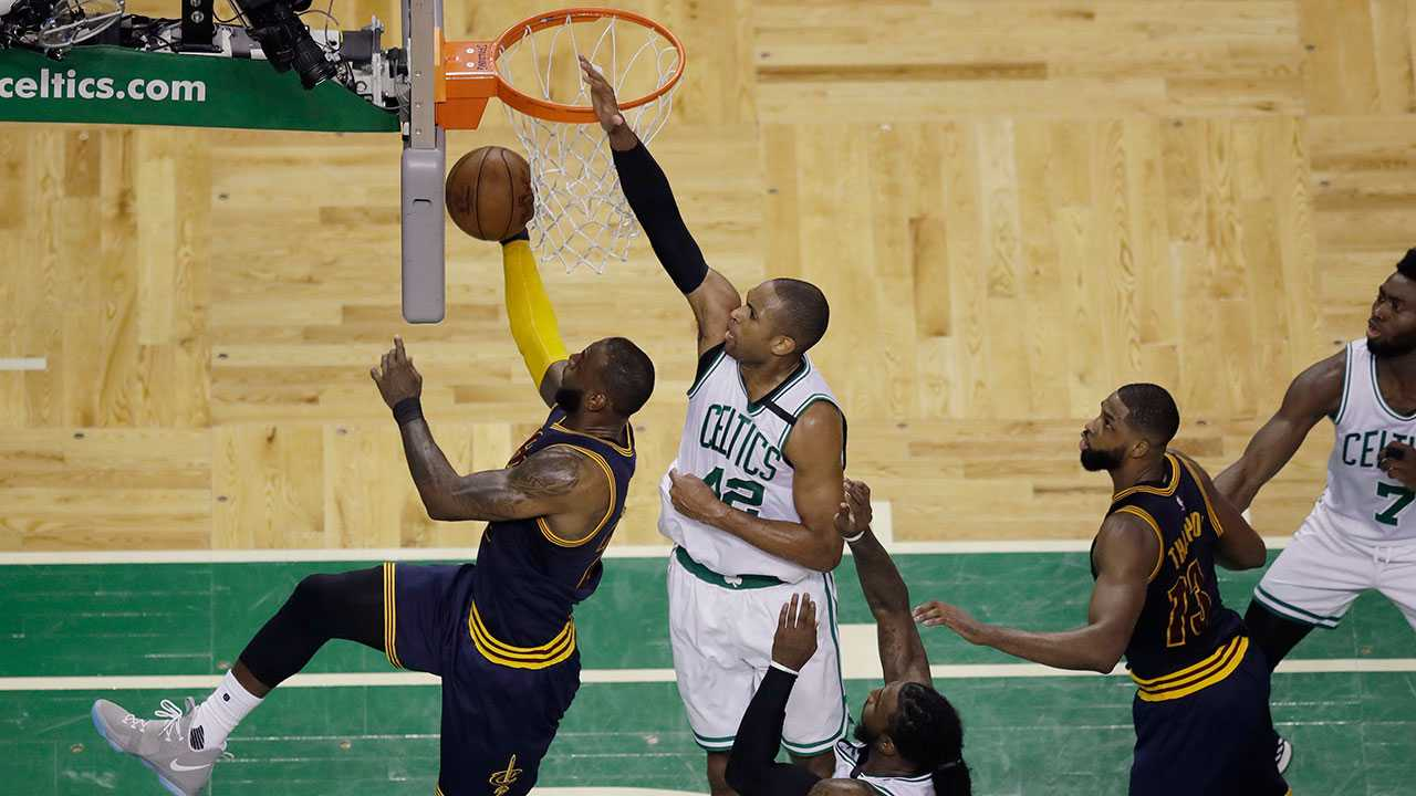 Cleveland Cavaliers forward LeBron James, left, drives for a layup in front of Boston Celtics center Al Horford (42) during the second quarter of Game 1 of the NBA basketball Eastern Conference finals, Wednesday, May 17, 2017, in Boston.