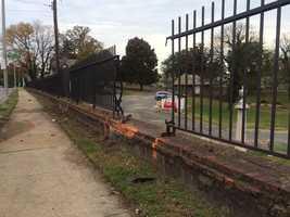 damaged fence at bus crash scene