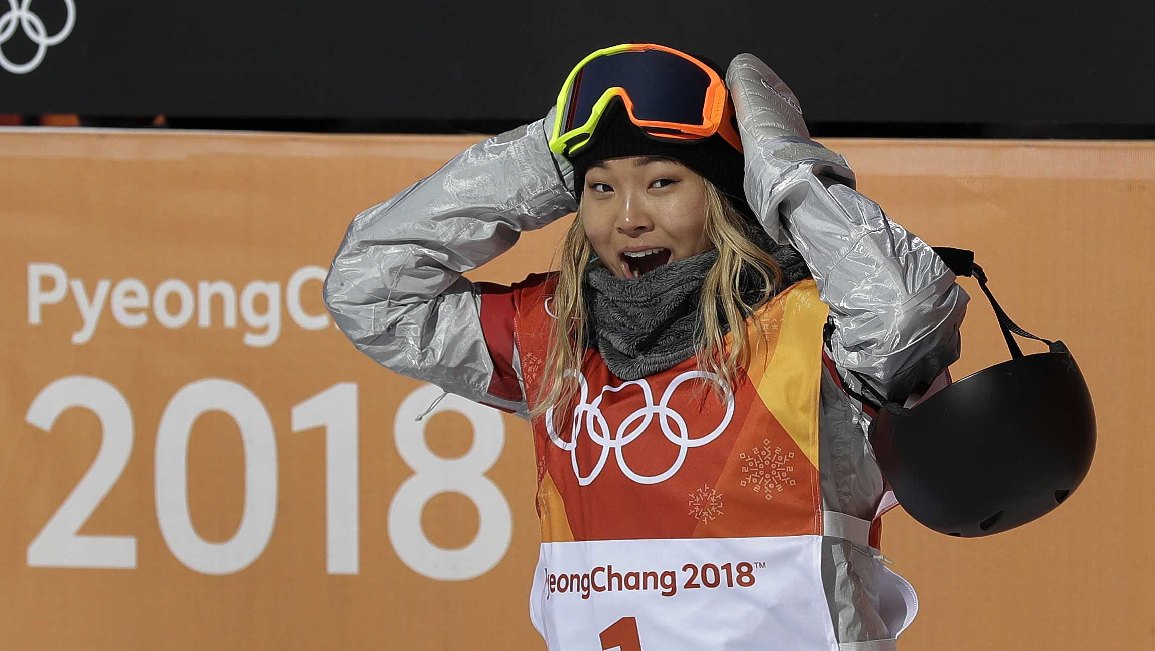 Chloe Kim, of the United States, reacts to her score during the women's halfpipe finals at Phoenix Snow Park at the 2018 Winter Olympics in Pyeongchang, South Korea, Tuesday, Feb. 13, 2018.