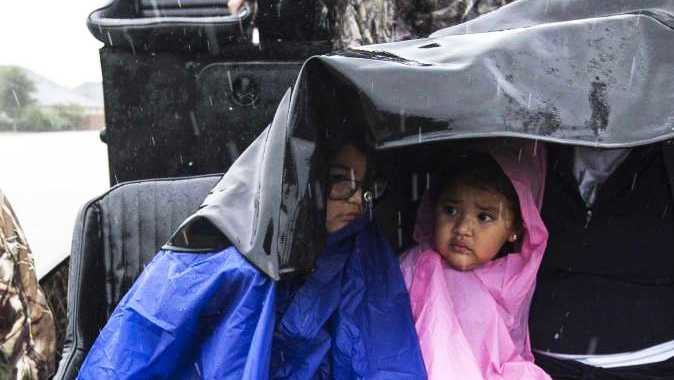 Children are evacuated from Harvey floodwaters.