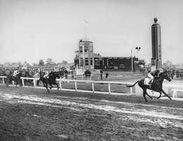Citation (1) crosses the finish line three and one half lengths ahead of his stablemate, Coal Town (1A) to win the Kentucky Derby at Churchill Downs, in Louisville, Ky., on May 1, 1948.