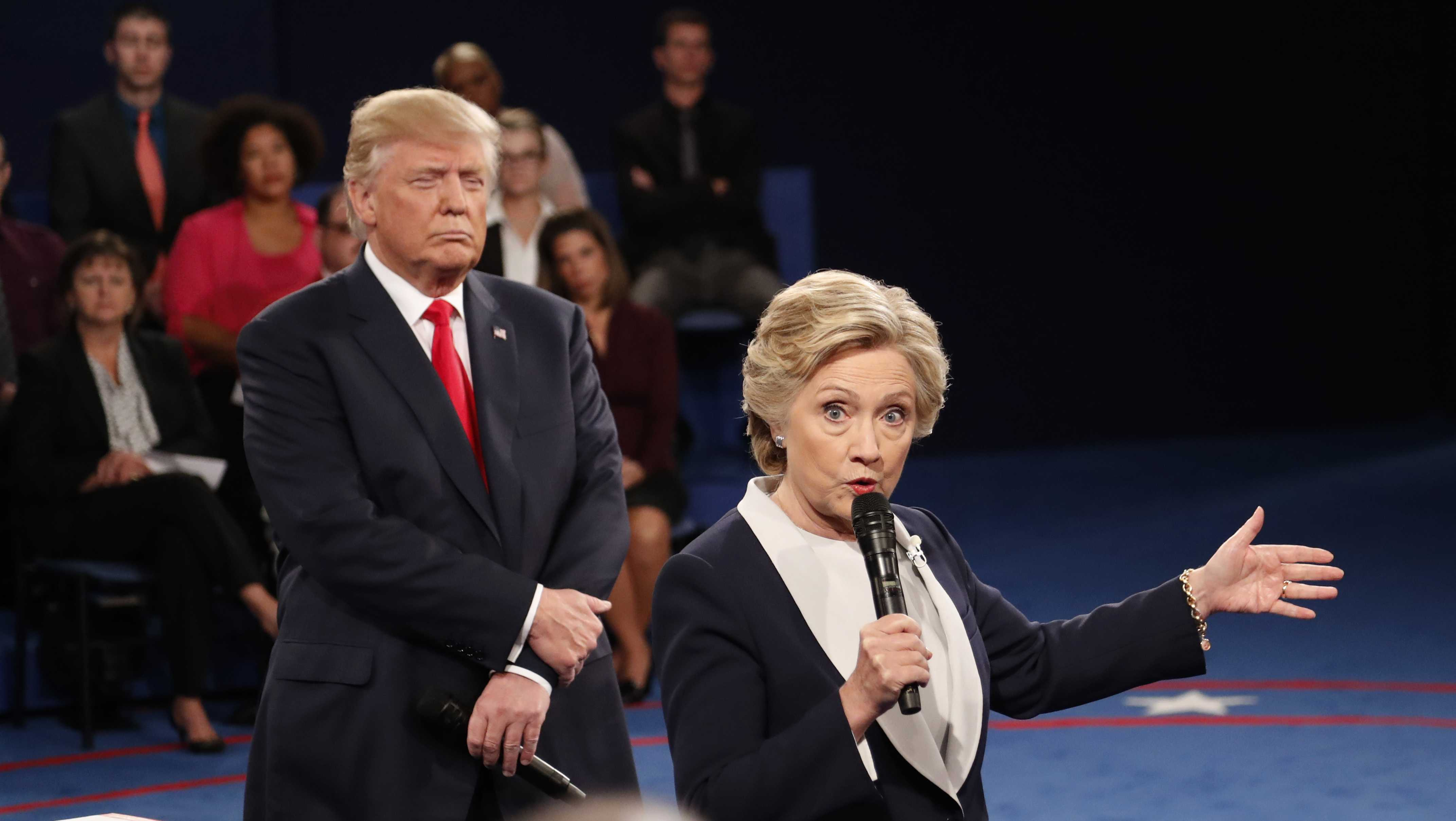 Then-Democratic presidential nominee Hillary Clinton speaks as then-Republican presidential nominee Donald Trump listens during the second presidential debate at Washington University in St. Louis, Sunday, Oct. 9, 2016.