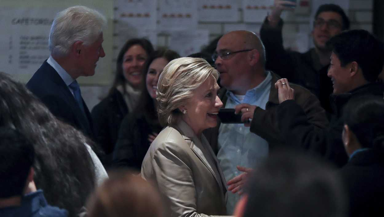 Democratic presidential candidate Hillary Clinton, accompanied by her husband, former President Bill Clinton, arrives to vote at Douglas G. Grafflin School in Chappaqua, N.Y.