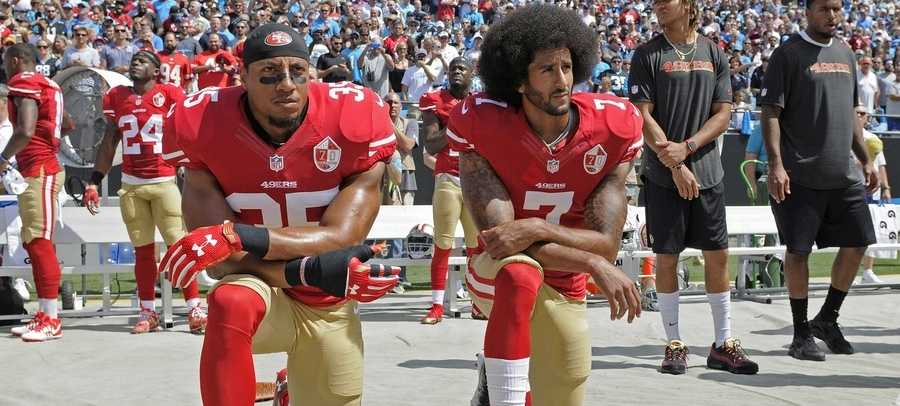 San Francisco 49ers safety Eric Reid (35) and quarterback Colin Kaepernick (7) kneel during the national anthem before an NFL football game against the Los Angeles Rams in Santa Clara, Calif., Monday, Sept. 12, 2016.
