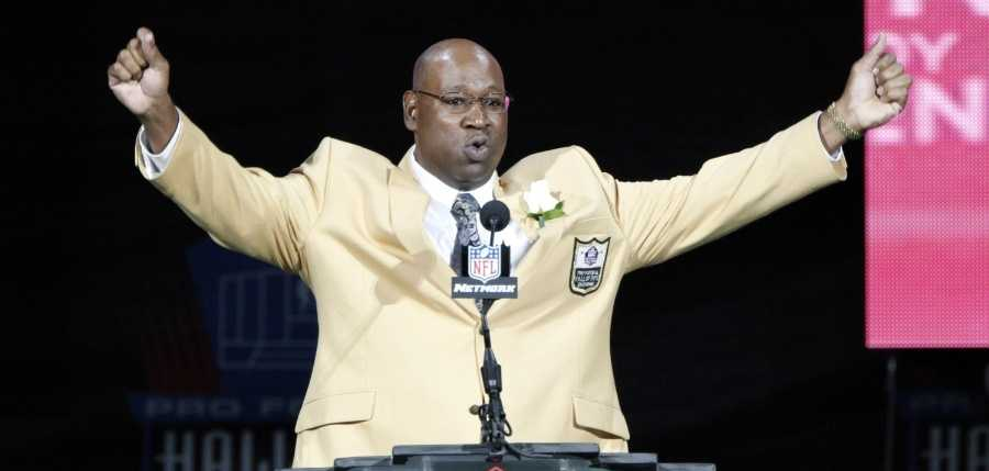 Former NFL player Cortez Kennedy gestures during his induction at the Pro Football Hall of Fame on Saturday, Aug. 4, 2012, in Canton, Ohio.
