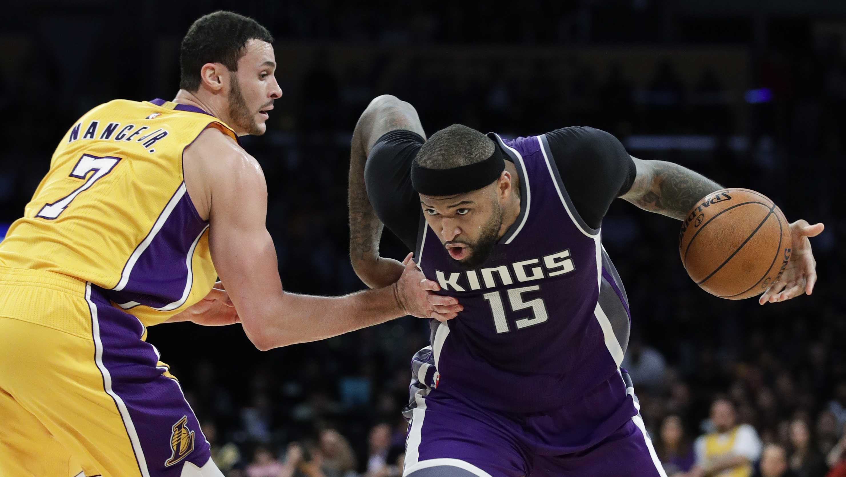 Sacramento Kings' DeMarcus Cousins, right, drives past Los Angeles Lakers' Larry Nance Jr. during the second half of an NBA basketball game, Tuesday, Feb. 14, 2017, in Los Angeles.