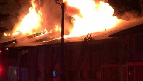 Mom drops baby, 2 children from 3rd story window to hero's arms during fire