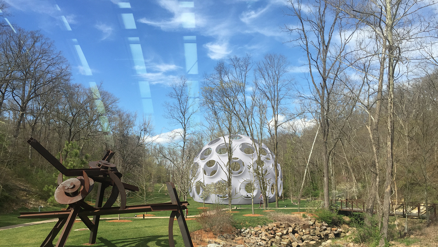 3D computer rendering of Buckminster's Fly Eye Dome as it will appear on the North Lawn at Crystal Bridges Museum of American Art. (View from Early 20th Century Gallery Bridge.)