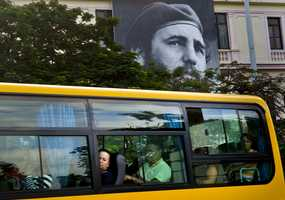 An image of Fidel Castro hangs on a building in Havana, Cuba, Saturday, Nov. 26, 2016. Castro, who led a rebel army to improbable victory in Cuba, embraced Soviet-style communism and defied the power of U.S. presidents during his half century rule, died at age 90 late Friday.