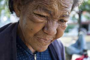 Former teacher Adis Tamayo cries as she mourns the death of Cuban leader Fidel Castro, in Havana, Cuba.