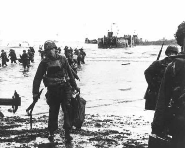 Soldiers move onto Omaha Beach during the Allied Invasion of Europe on D-Day, June 6, 1944.