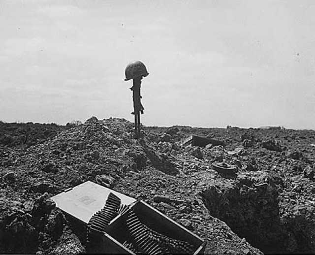 Fellow soldiers erected this monument to an American soldier somewhere on the shell-blasted coast of Normandy.