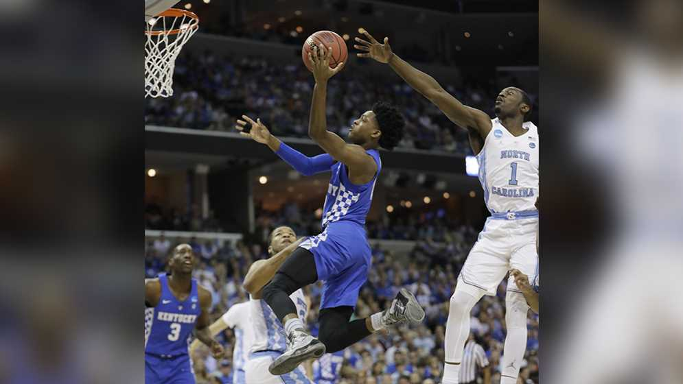 Kentucky guard De'Aaron Fox (0) shoots against North Carolina forward Theo Pinson (1) in the first half of the South Regional final game in the NCAA college basketball tournament Sunday, March 26, 2017, in Memphis, Tenn.