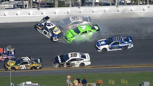 Chase Elliott (9), Kasey Kahne (95) and Danica Patrick (7) collide between Turns 3 and 4 as Ryan Newman (31), Aric Almirola (10) and Alex Bowman (88) avoid them in the NASCAR Daytona 500 auto race at Daytona International Speedway Sunday, Feb. 18, 2018, in Daytona Beach, Fla.