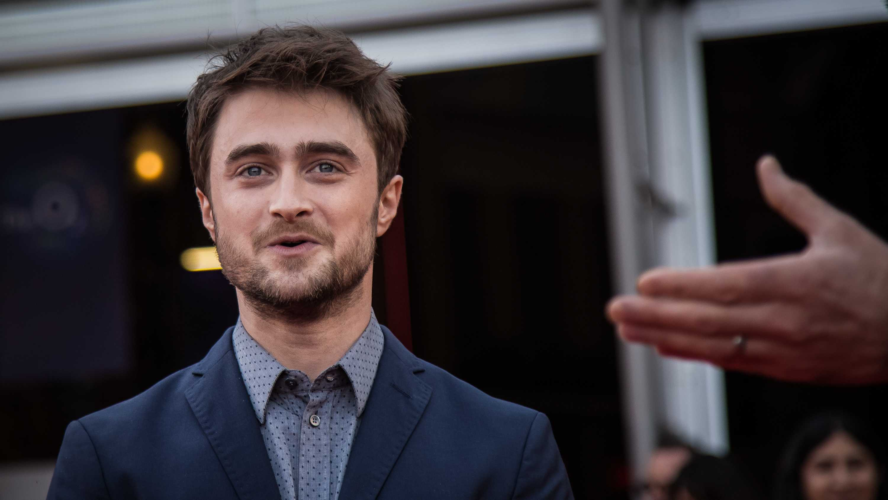Daniel Radcliffe poses for photographers upon arrival at the Empire Live event, in London, Friday, Sept. 23, 2016.