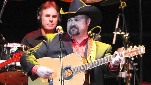 "In this Nov. 22, 2013 file photo, Daryle Singletary performs at a tribute to George Jones in Nashville, Tenn. Singletary, who sang songs like ""I Let Her Lie"" and ""Too Much Fun,"" died Monday, Feb. 12, 2018, at his home in Lebanon, Tenn. He was 46."