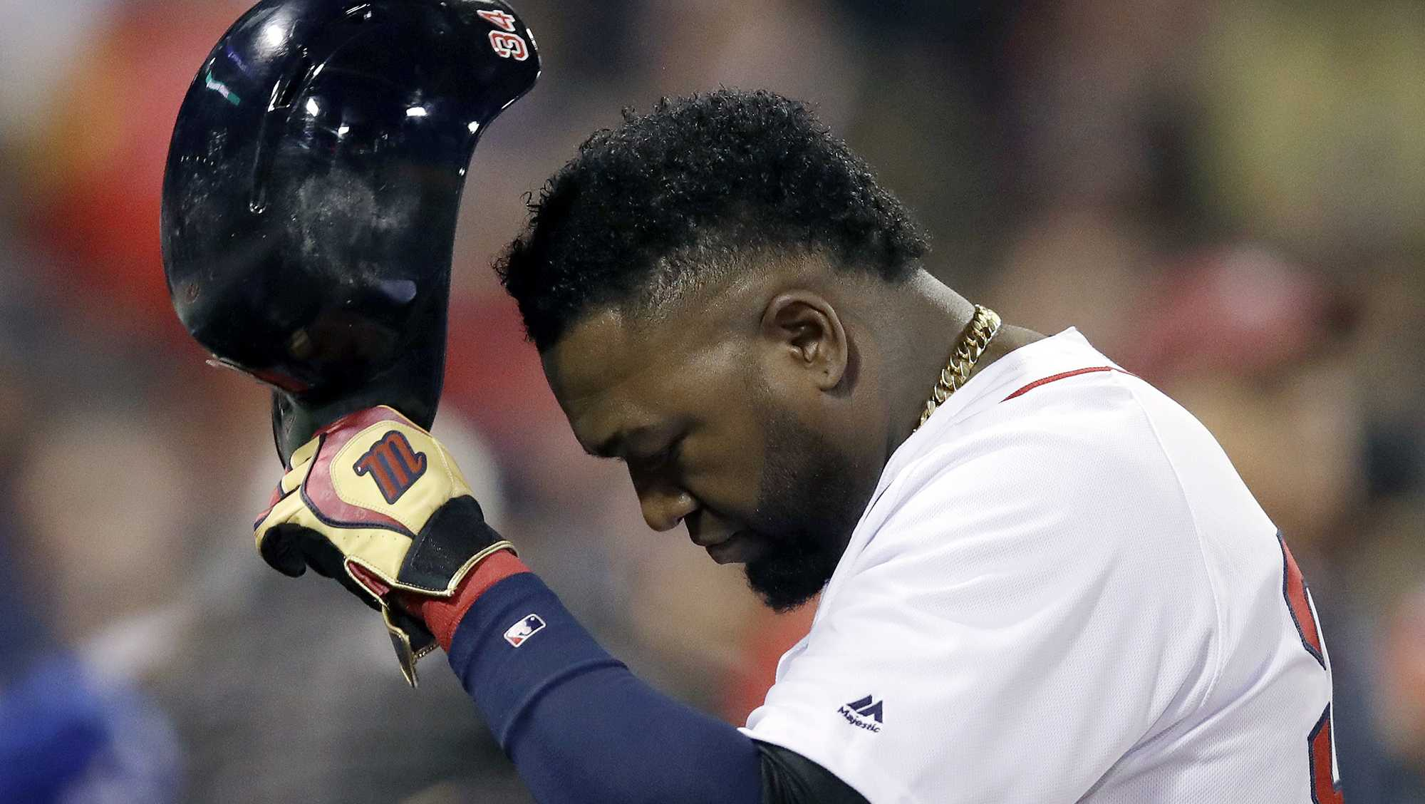 David Ortiz of the Red Sox returns to the dugout after grounding out during Game 3 of the ALDS on Monday night at Fenway Park. It was the celebrated slugger's final game.